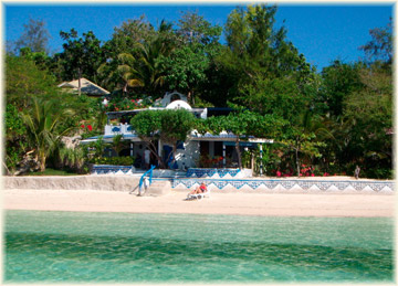 Relax on the white beach in front of Your charming accommodation.